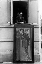 Alban Berg in Vienna with his portrait as painted by Arnold Schönberg